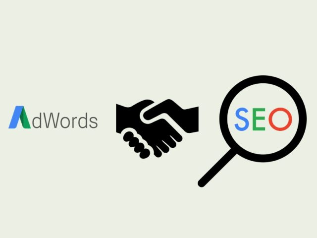 Adwords and SEO with a handshake in the middle for marketing solutions